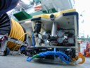 ROV with grab and recovery line